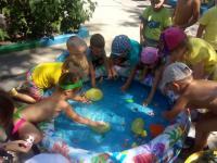 Летний праздник Нептуна для детей всех возрастных групп на свежем воздухе. Мероприятие получилось развлекательным, познавательным, с закаливающим характером.
